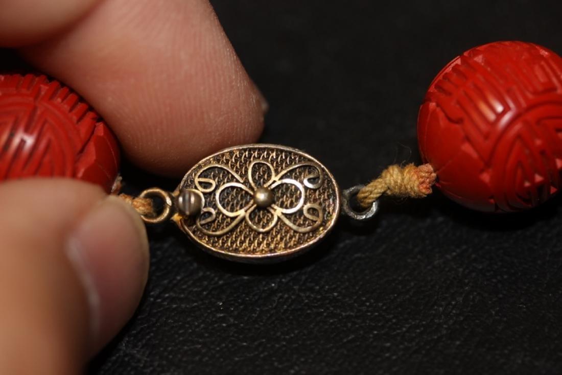A Cinnabar and Bone Necklace - 7
