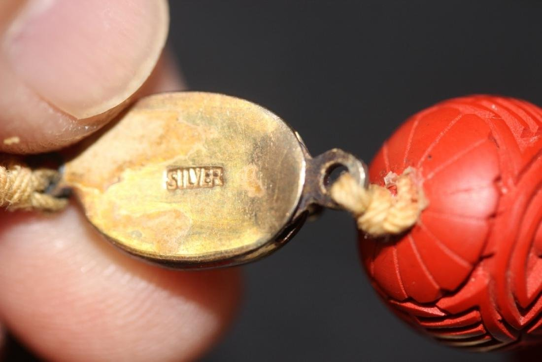 A Cinnabar and Bone Necklace - 8