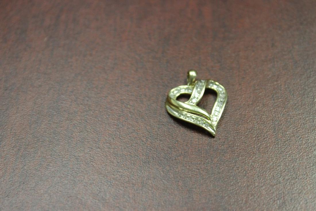 A 10Kt Gold and Diamond Pendant