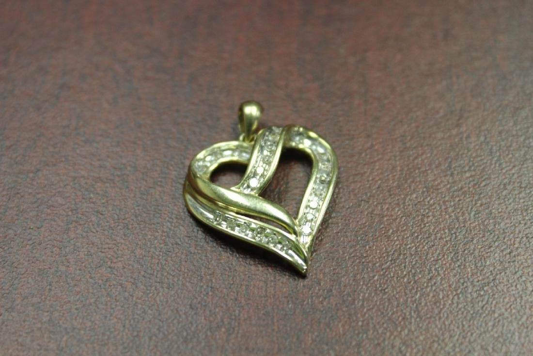 A 10Kt Gold and Diamond Pendant - 2