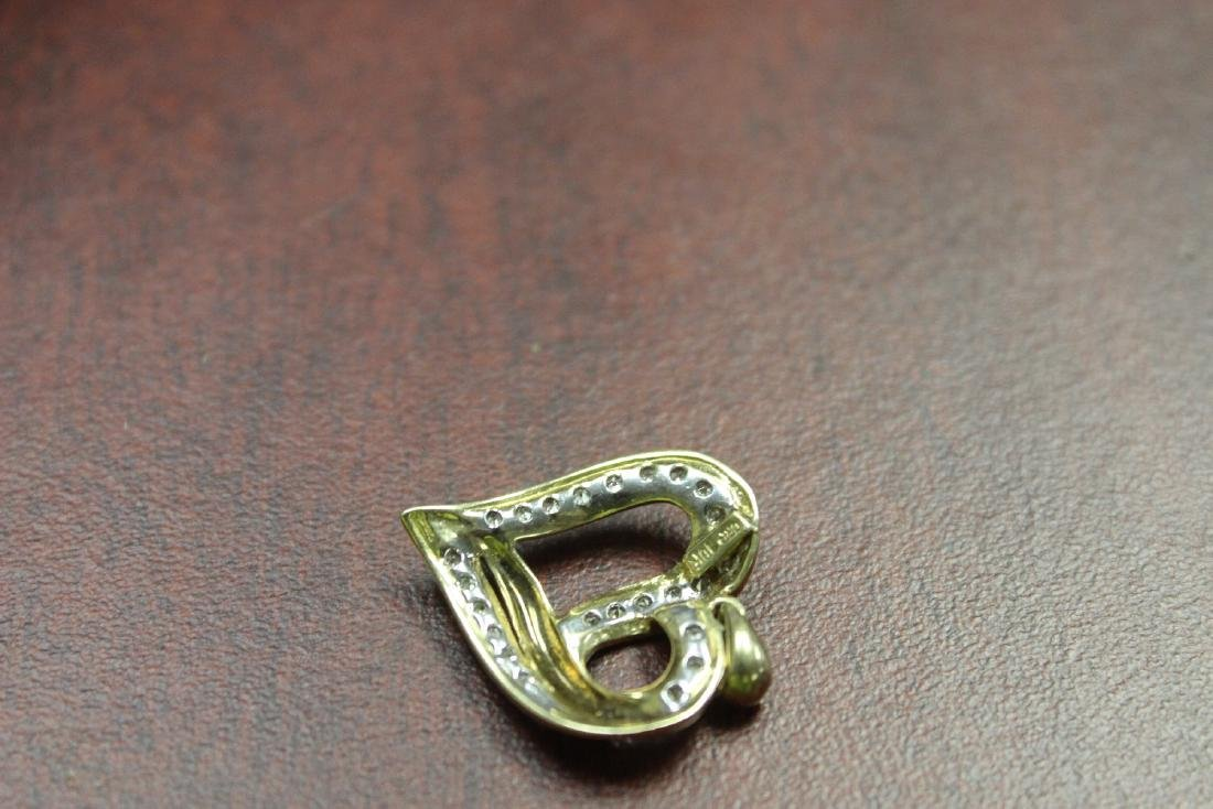 A 10Kt Gold and Diamond Pendant - 4