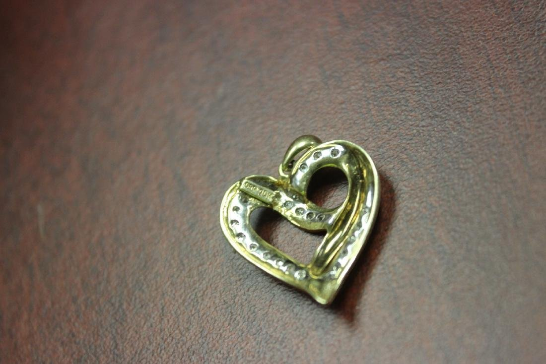 A 10Kt Gold and Diamond Pendant - 5