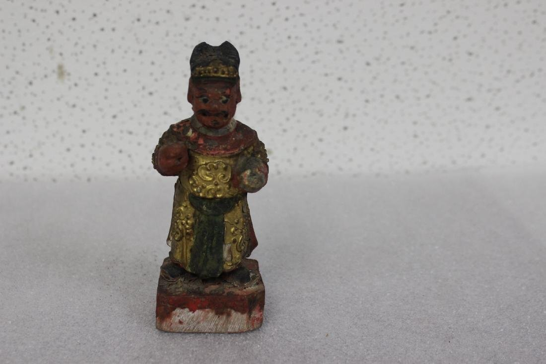 A Chinese Wooden Figurine