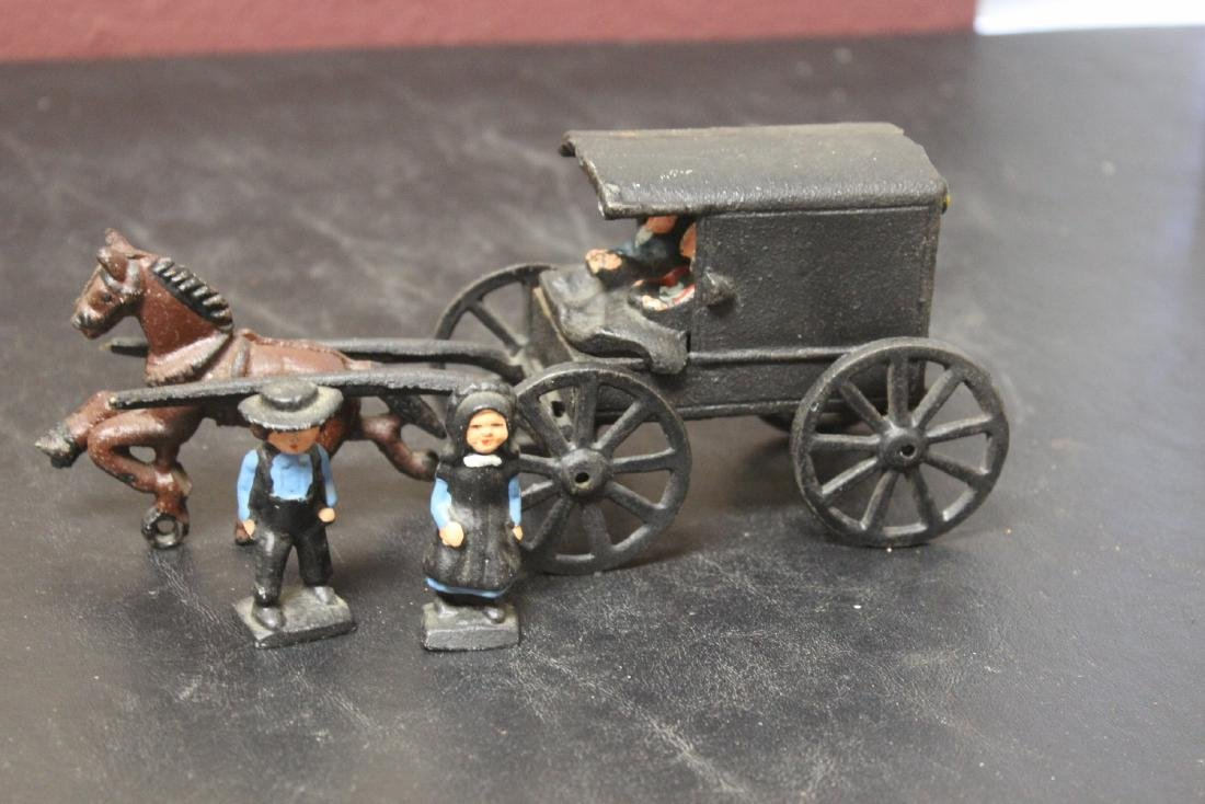 An Amish Carriage with Horse and Bystanders - 2