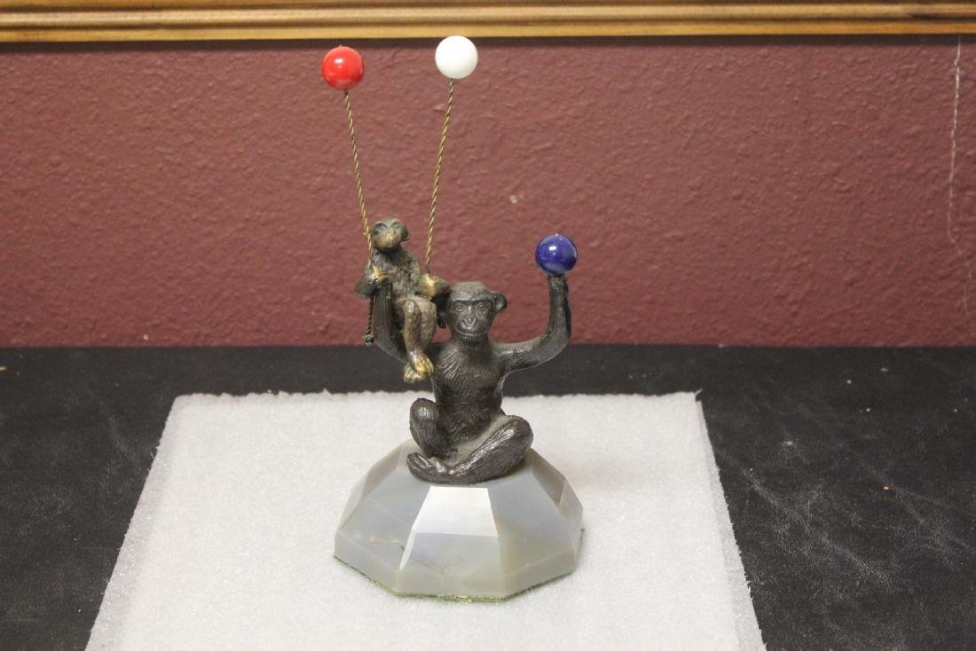 A Bronze Monkey with 3 Balloons
