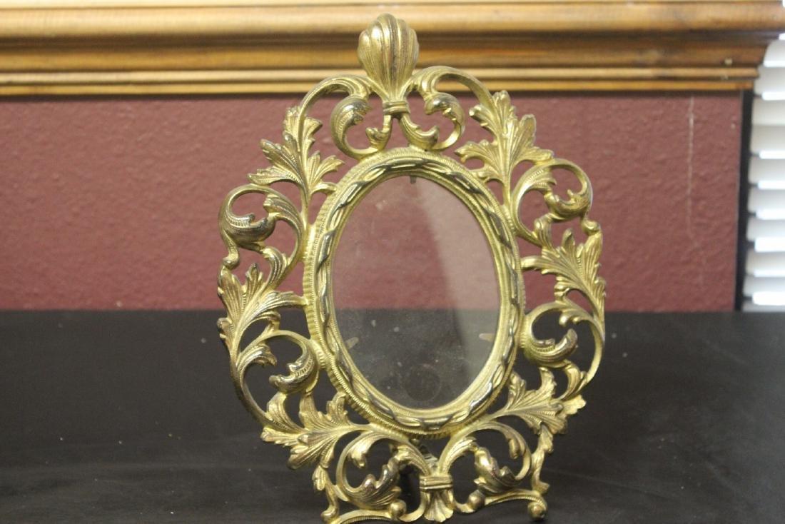 A Cast Iron Gold Frame