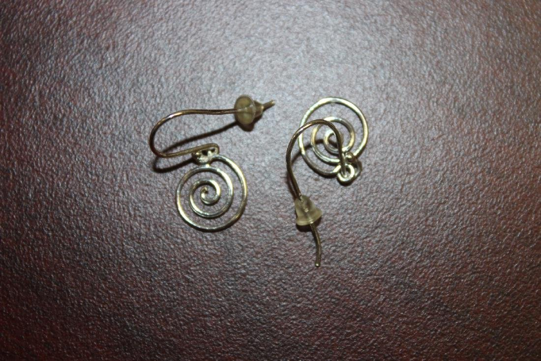 A 14Kt White Gold Pair of Earrings