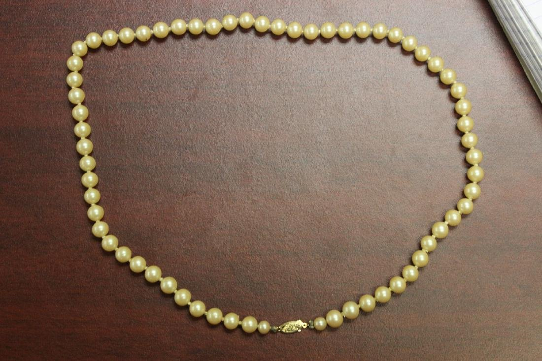 A 14Kt Gold Clasped Pearl Necklace