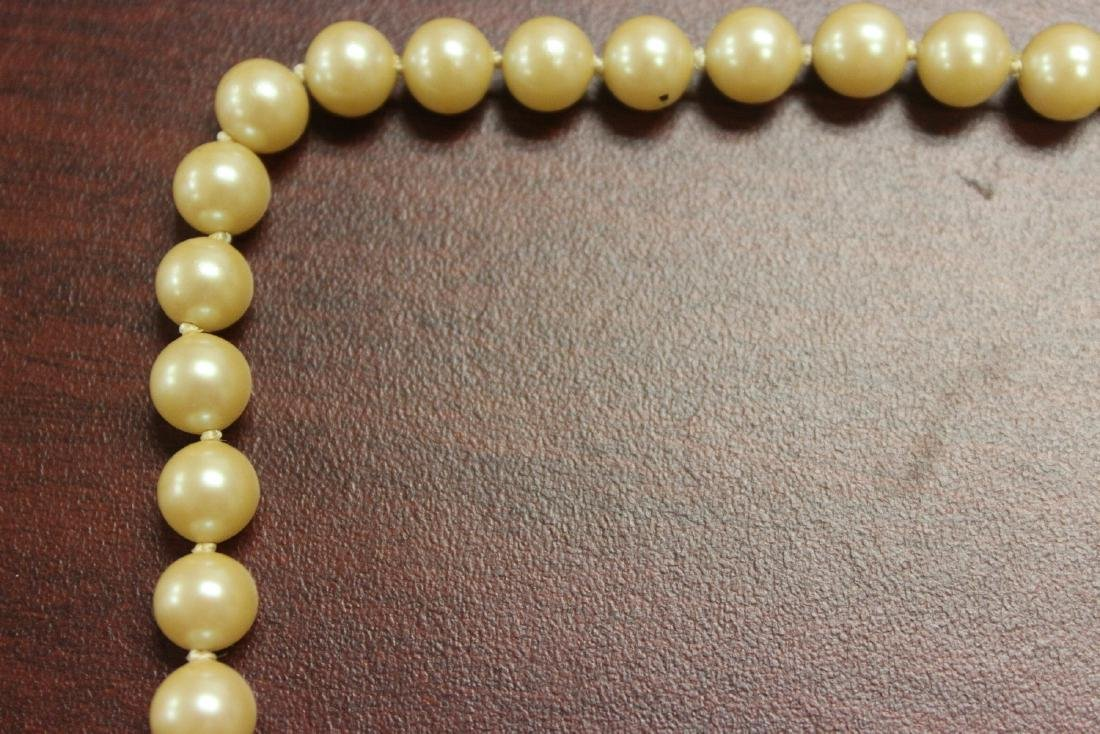 A 14Kt Gold Clasped Pearl Necklace - 6