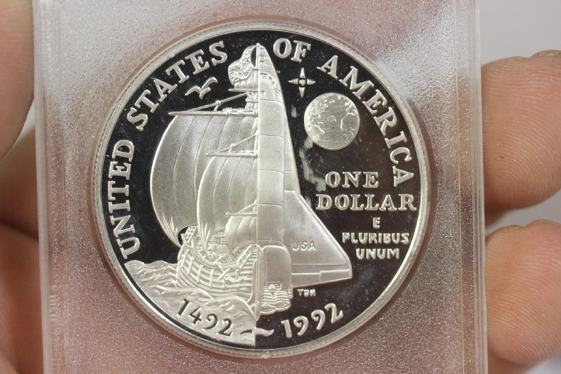 A 1992 P Columbus Silver Dollar - 3