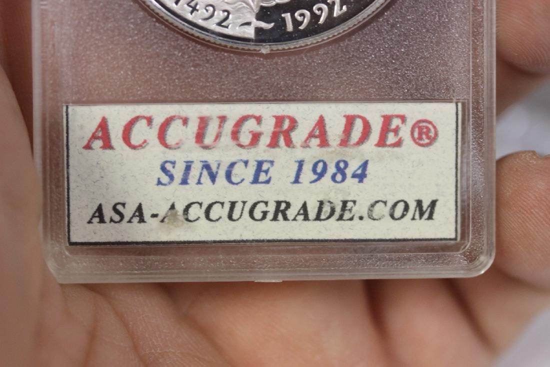 A 1992 P Columbus Silver Dollar - 4