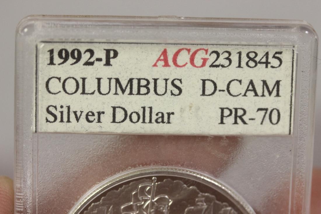 A 1992 P Columbus Silver Dollar - 5