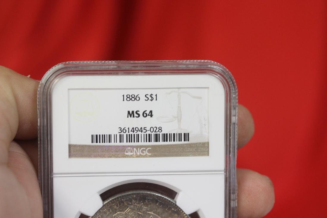 A Graded 1886 Morgan Silver Dollar - 6