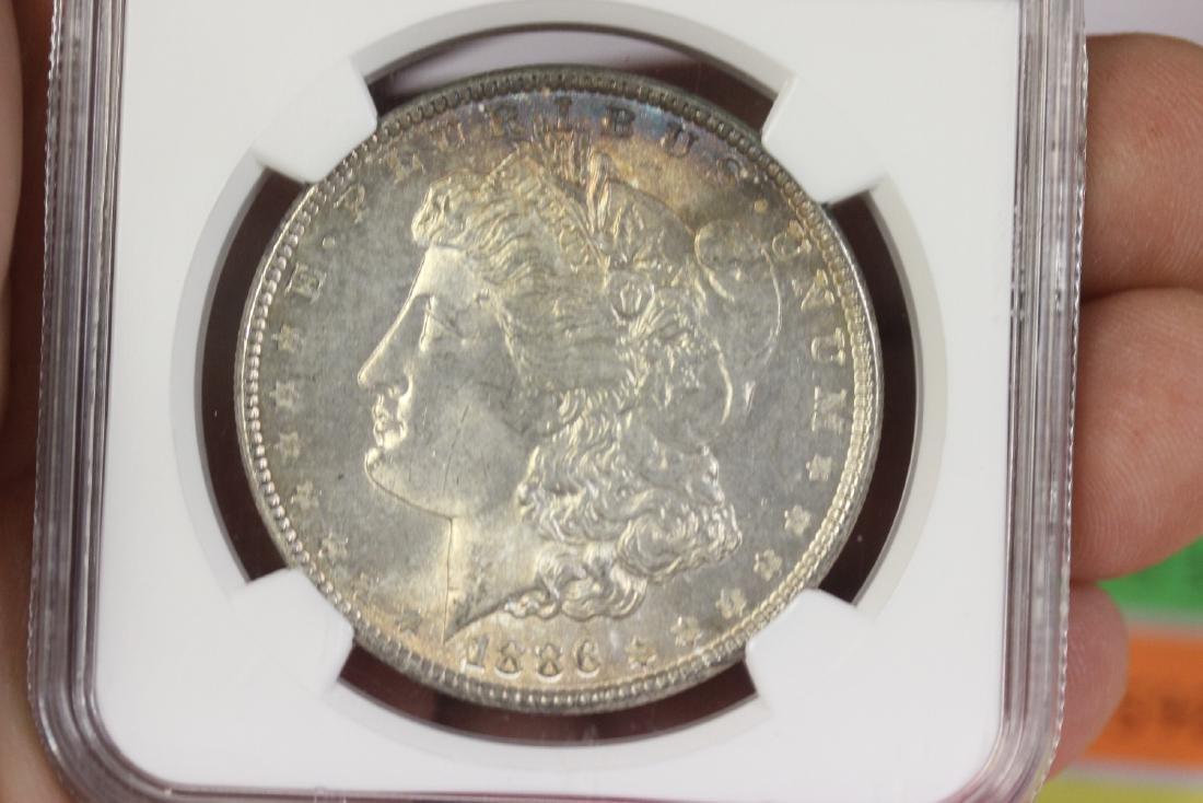 A Graded 1886 Morgan Silver Dollar - 7