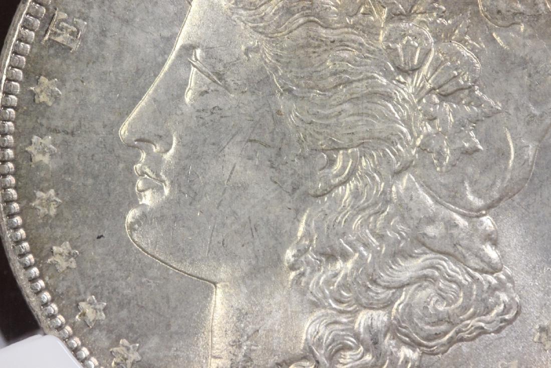 A Graded 1886 Morgan Silver Dollar - 9