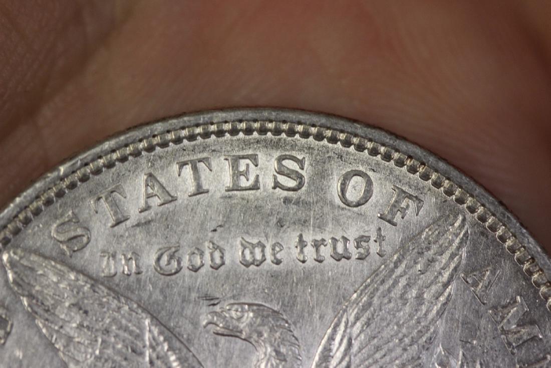 An 1880 Morgan Silver Dollar - 6