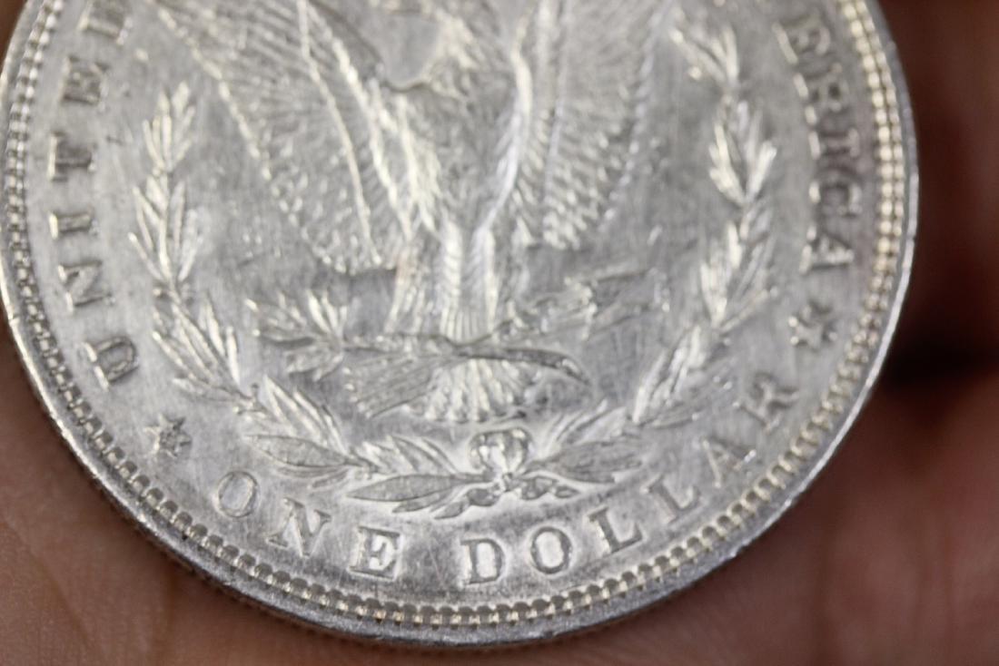An 1880 Morgan Silver Dollar - 8