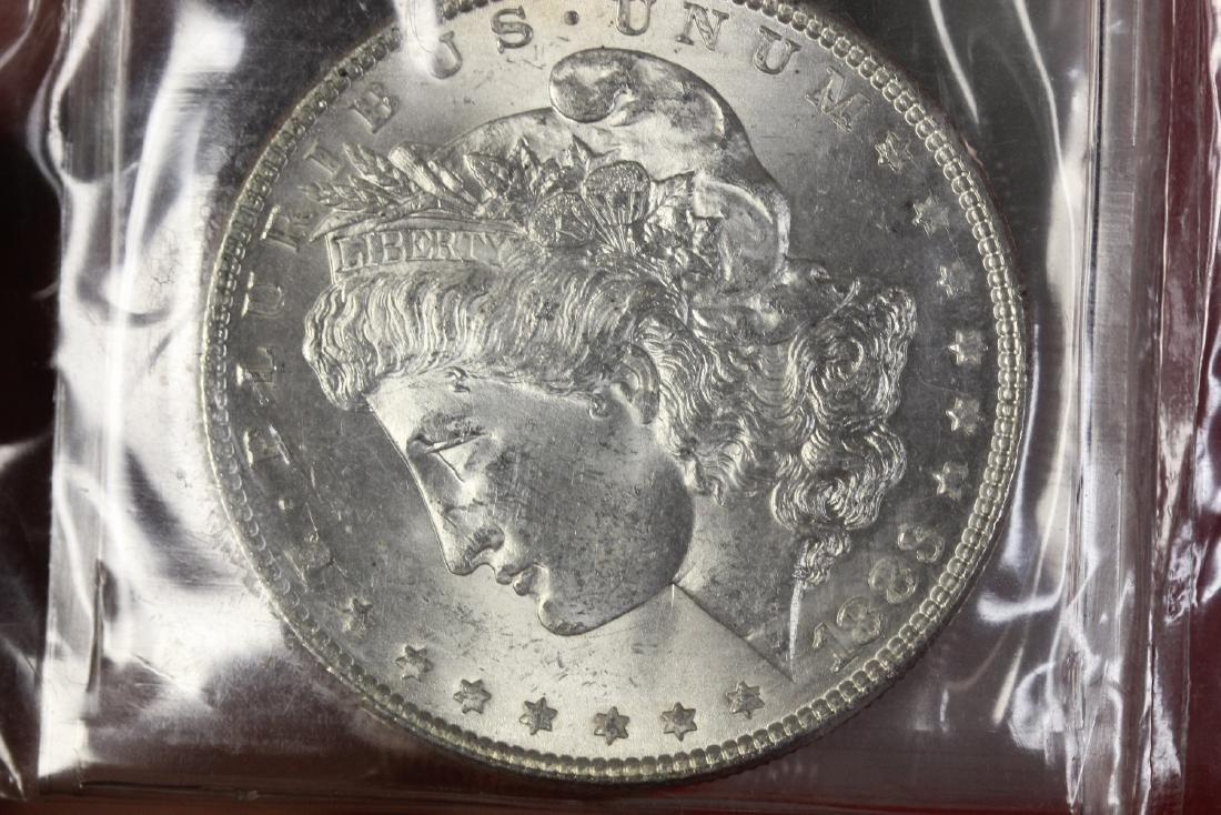 An 1883 P Morgan Silver Dollar - 2