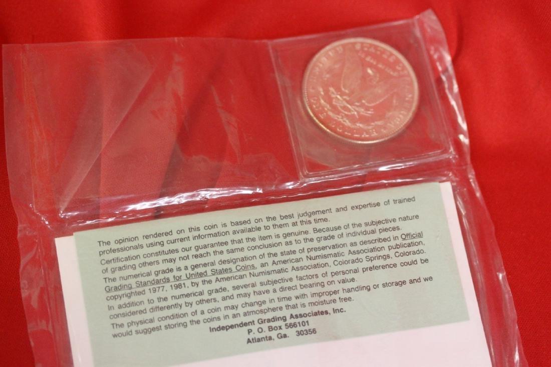 An 1883 P Morgan Silver Dollar - 5