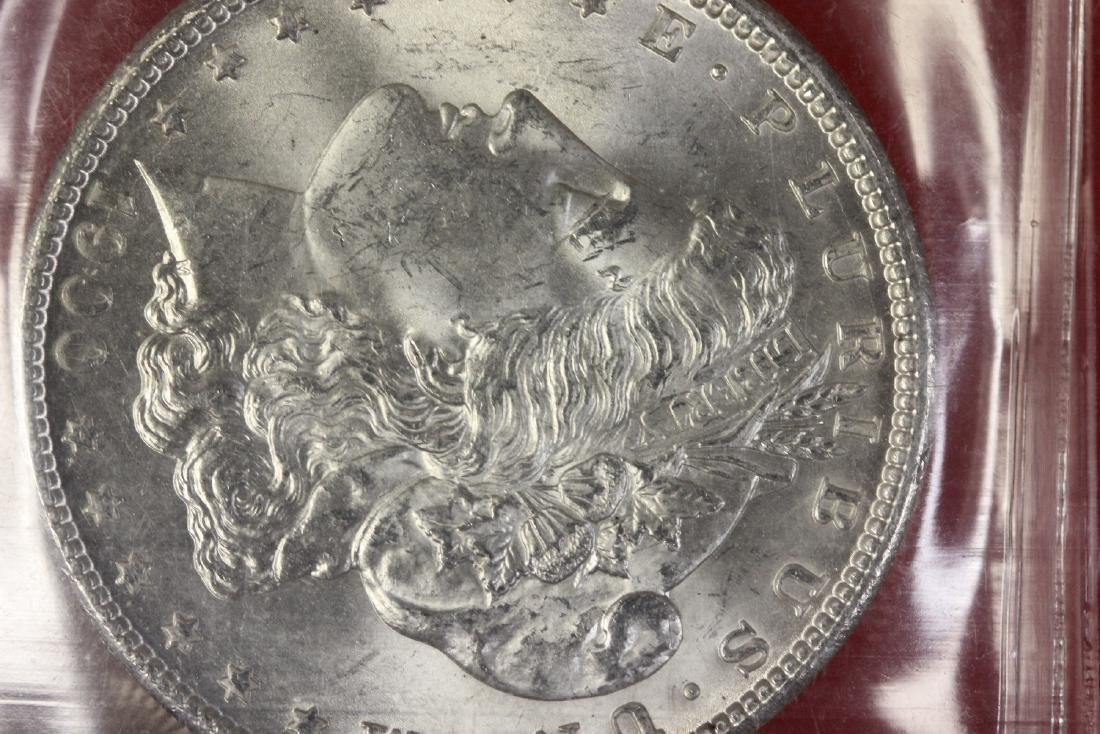 A 1900 P Morgan Silver Dollar - 2