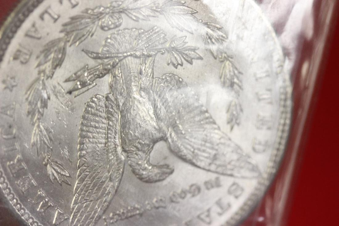 A 1900 P Morgan Silver Dollar - 6