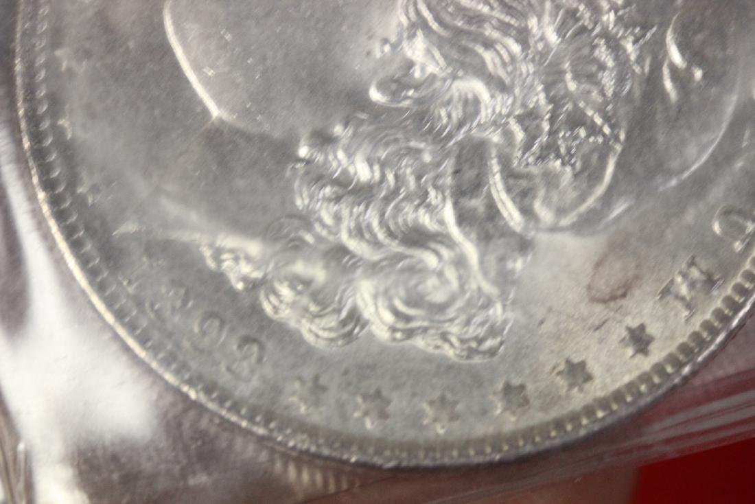 An 1898 P Morgan Silver Dollar - 3