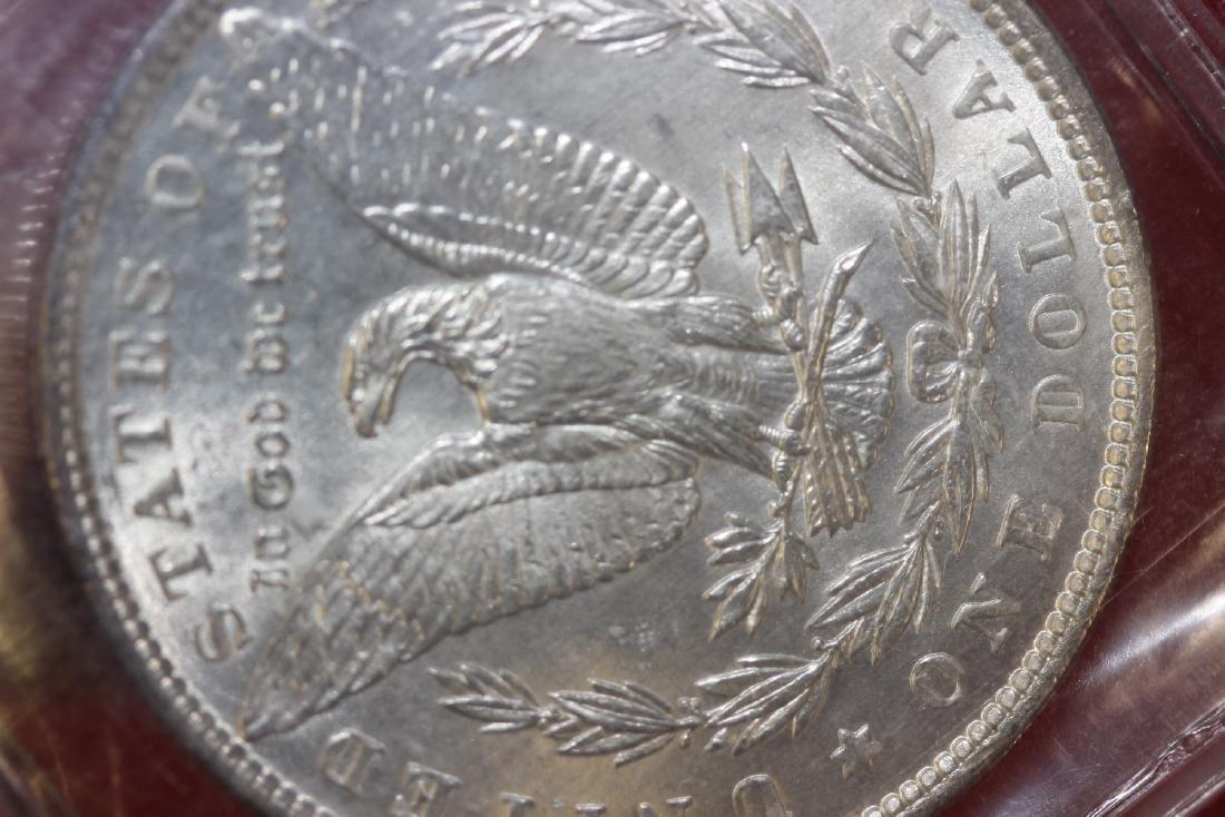 An 1898 P Morgan Silver Dollar - 5