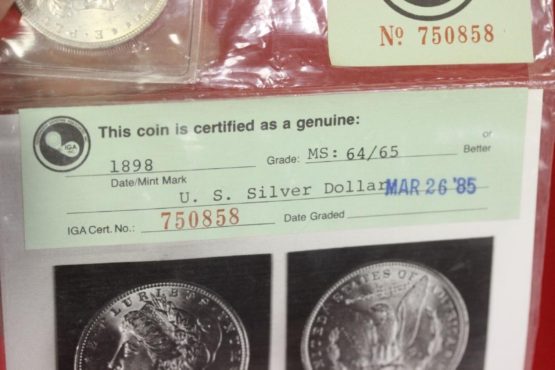An 1898 P Morgan Silver Dollar - 6