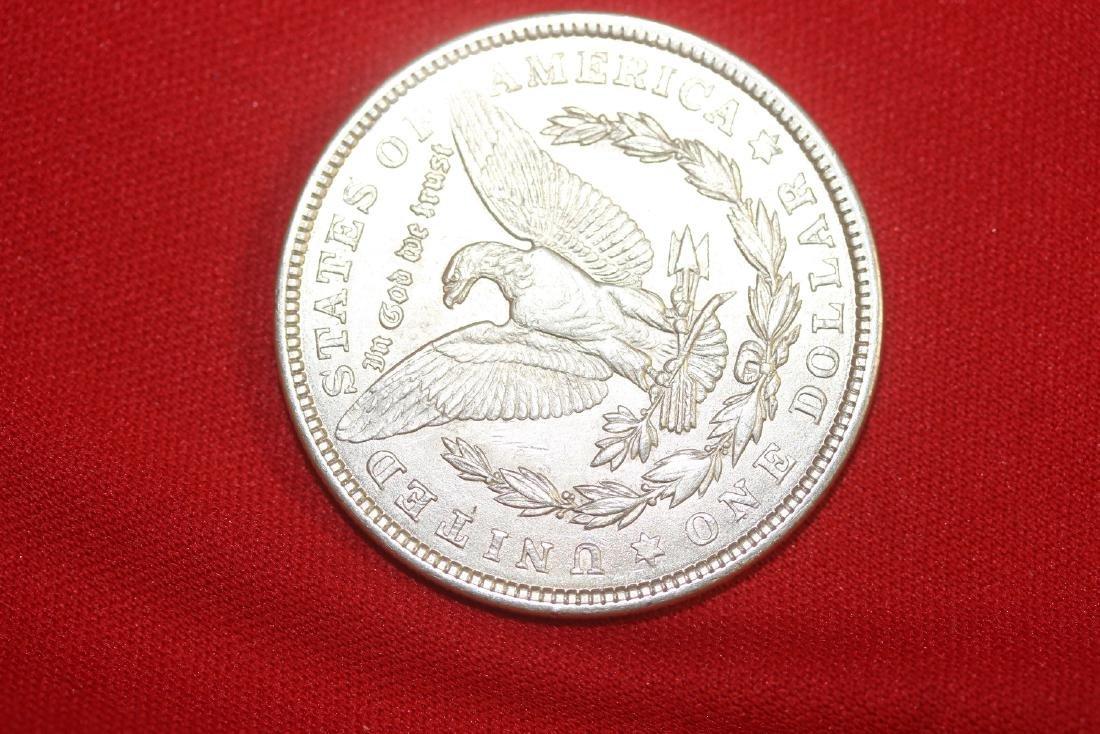 A 1921 Morgan Silver Dollar - 2