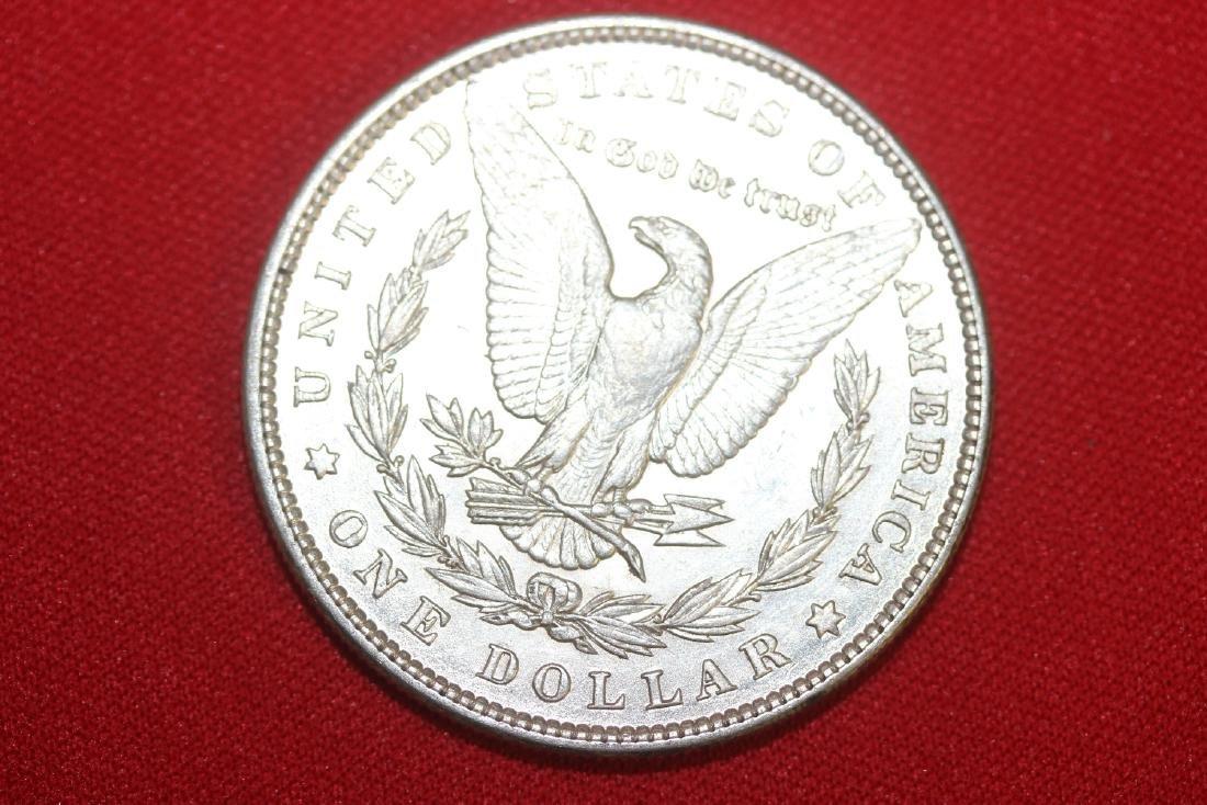 An 1889 Morgan Silver Dollar - 2