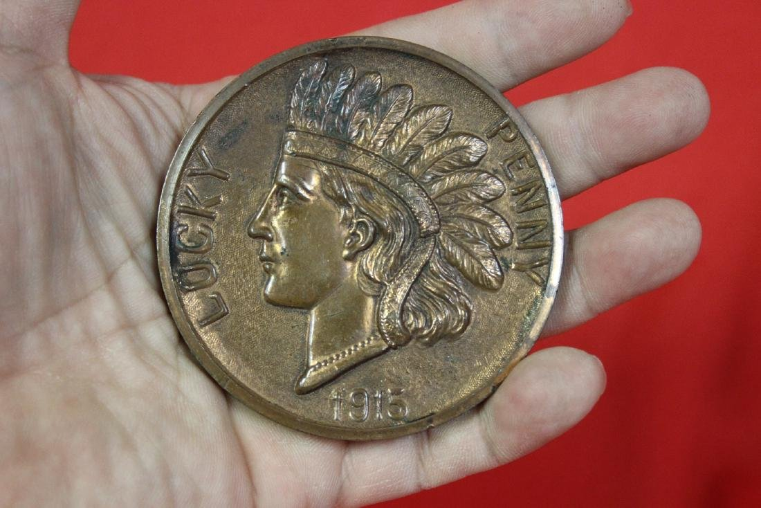 A Bronze or Metal Commemorative Indian Head Penny