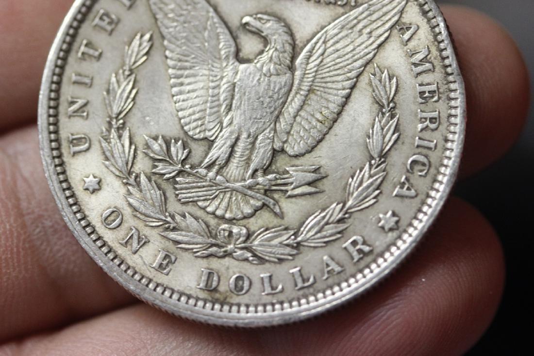A 1900 Morgan Silver Dollar - 4