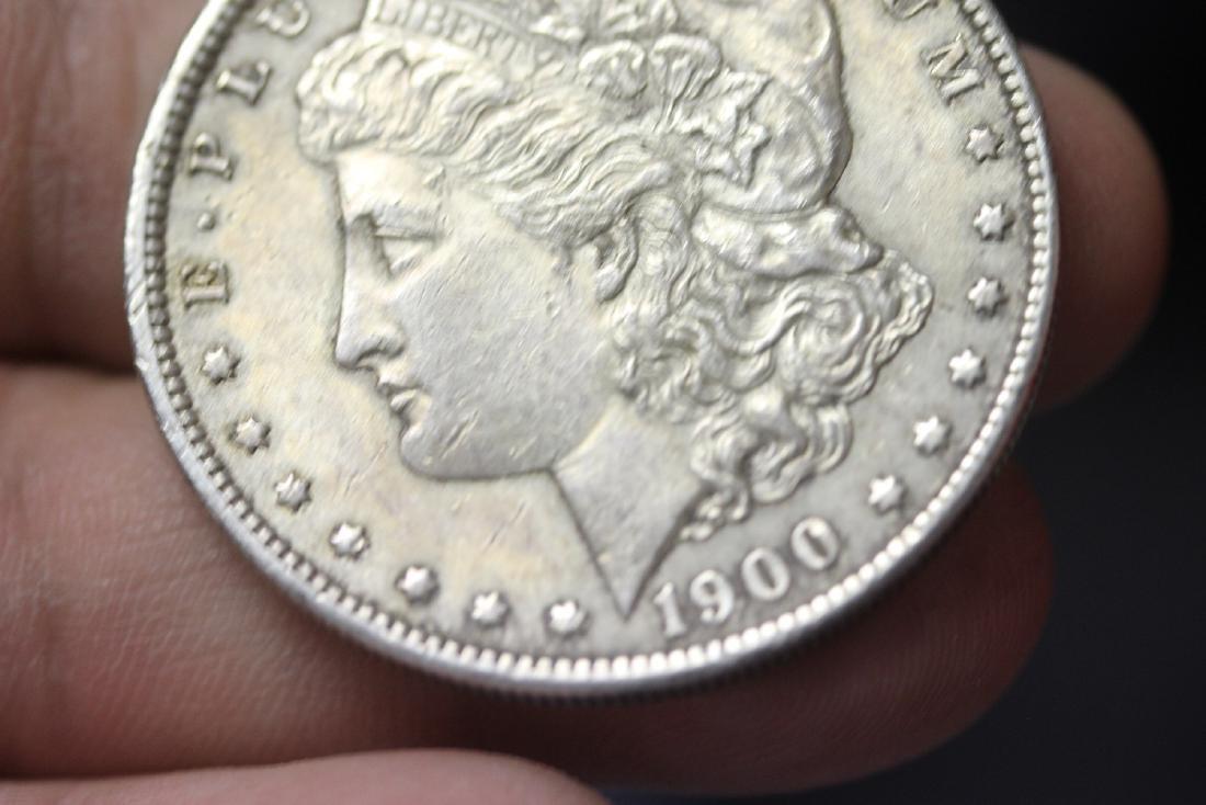 A 1900 Morgan Silver Dollar - 6