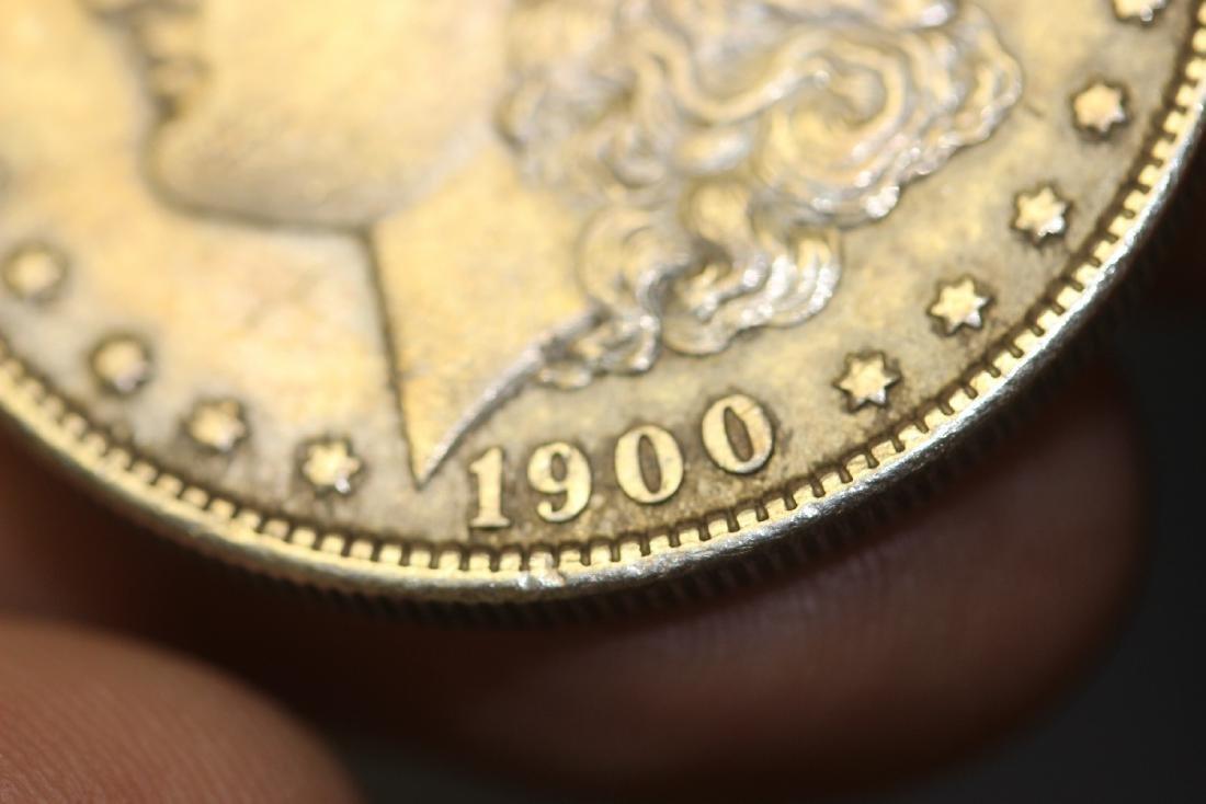 A 1900 Morgan Silver Dollar - 7