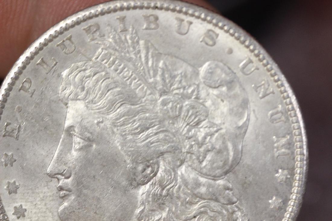 A 1900 Morgan Silver Dollar - 5
