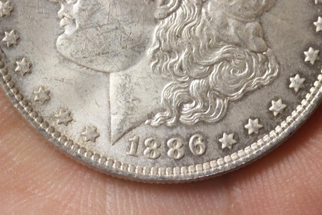 An 1886 Morgan Silver Dollar - 2