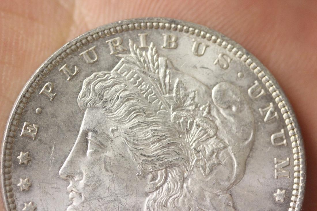 An 1886 Morgan Silver Dollar - 3