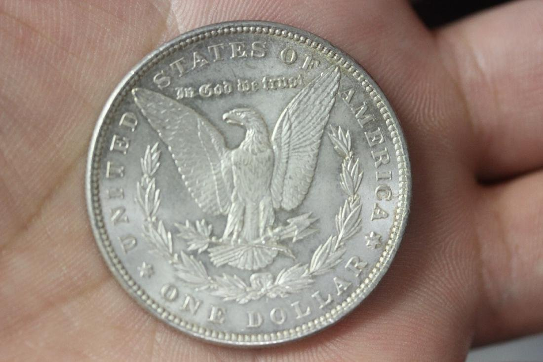 An 1886 Morgan Silver Dollar - 4