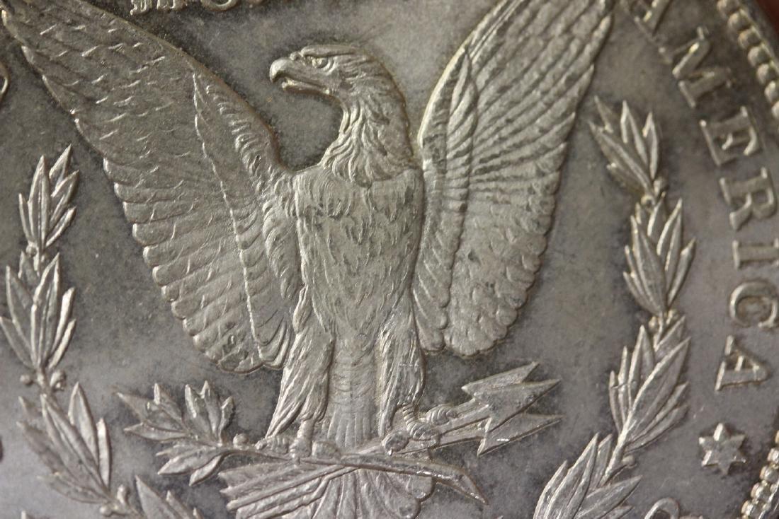 An 1886 Morgan Silver Dollar - 5