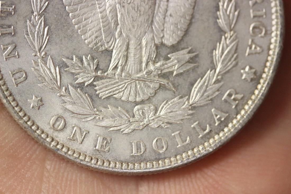 An 1886 Morgan Silver Dollar - 7