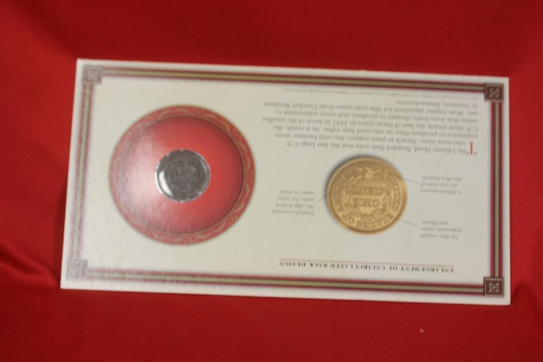 An 1853 Liberty Head Large Cent