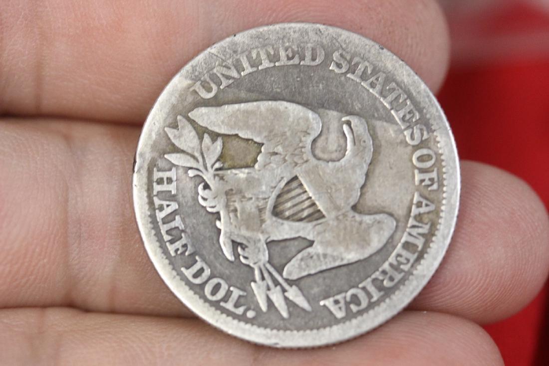 An 1854 Half Dollar