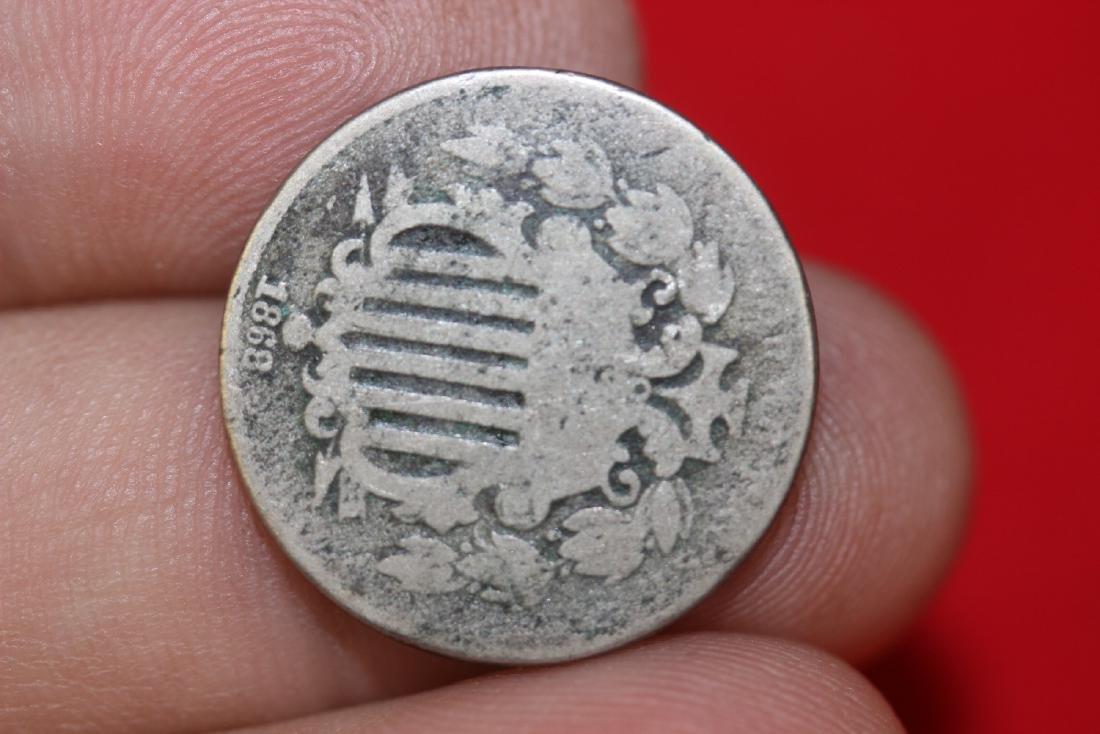 An 1868 Shield Nickel