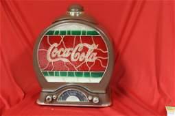 A Coca Cola Radio Cookie Jar