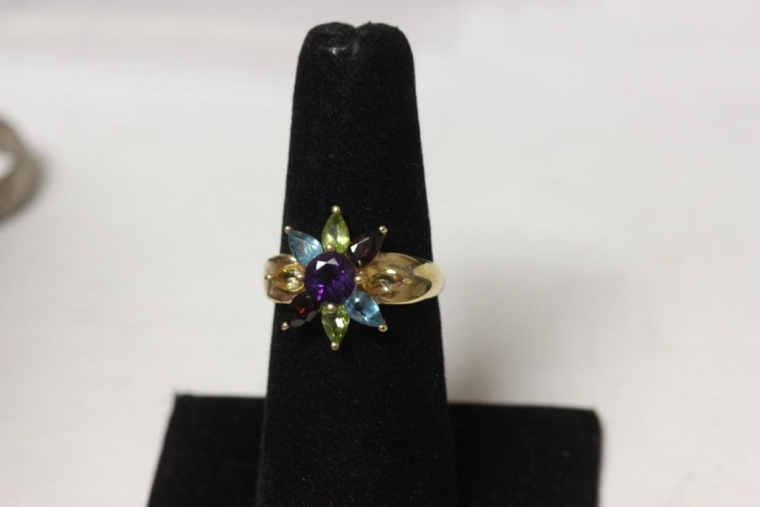 A 10 Kt Yellow Gold and Gemstone Ring