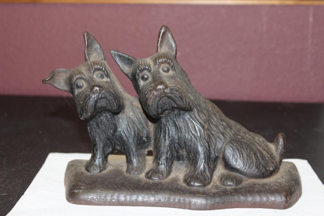 A Vintage Cast Iron Twin Dog Door Stopper