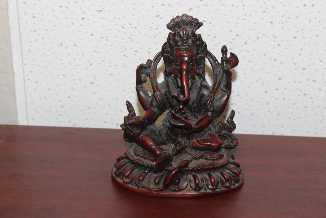 An Oriental Resin Figurine