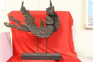 A Decorative Wooden Oriental Statue