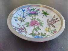 A Ceramic Bowl With Pewter Decorative Cover