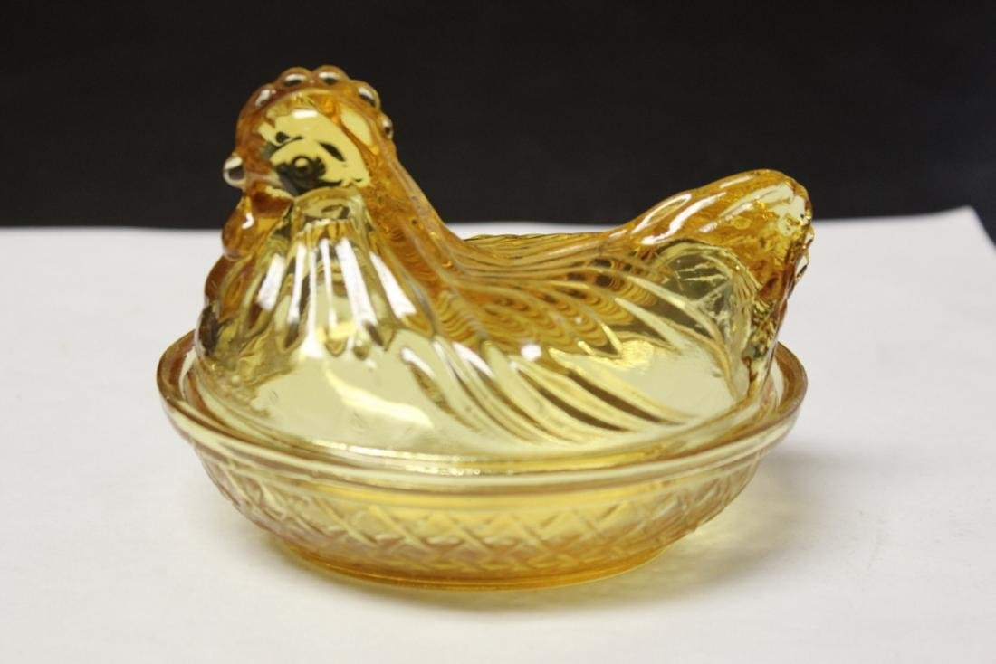 An Amber Glass Chicken Candy Dish